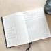 Коричневый ежедневник формата А4 со страницами для самоанализа.